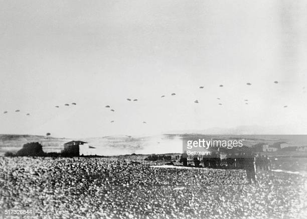 AS Nazi Parachuters Swept upon Crete Radioed from Berlin this striking picture [of the] Nazi parachute invasion of the Island of Crete Scores of Nazi...