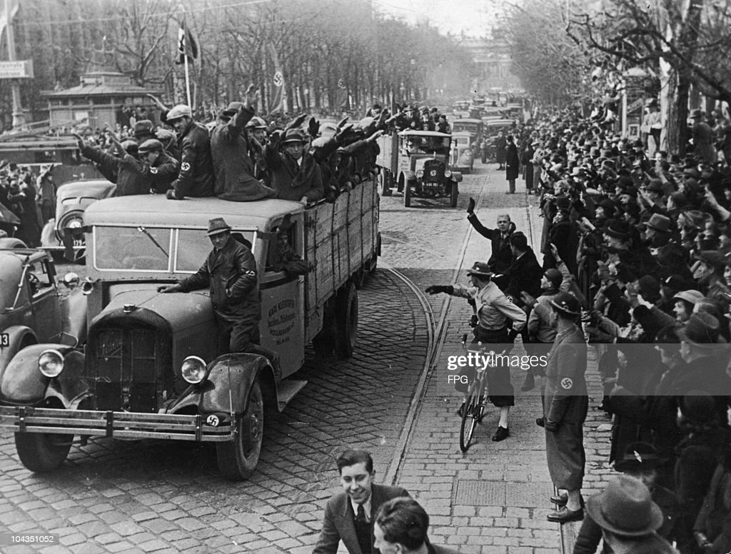Nazi Party members drive through the streets of Vienna in celebration on the day after the Anschluss, or annexation of Austria to Nazi Germany, 13th March 1938.