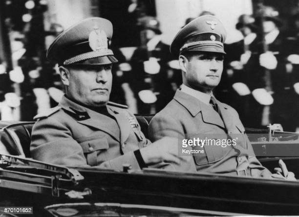 Nazi Party official Rudolf Hess in a car with Italian leader Benito Mussolini circa 1938