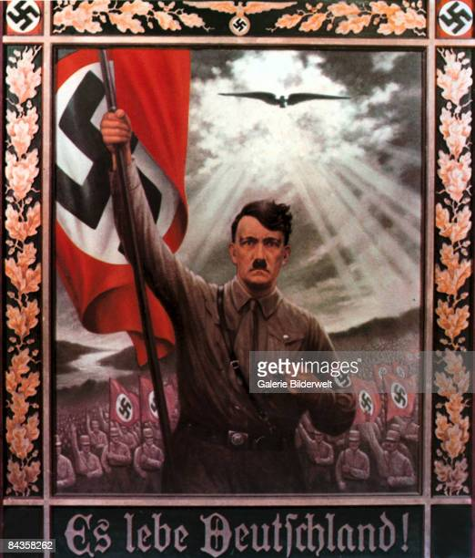 A Nazi Party poster depicts Adolf Hitler bearing the German flag at the head of a vast army with the caption 'Es Lebe Deutschland' circa 1935 Poster...