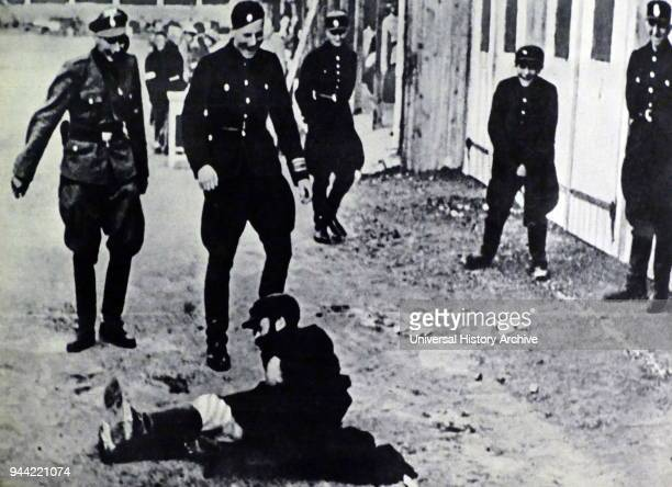 Nazi Police and soldiers attack a Jewish man in Gdansk, Poland after the German occupation of 1939.