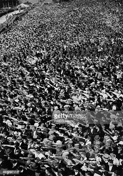 Nazi rally Ehrenbreitstein Germany August 1934 A large crowd gives the Nazi salute A print from Adolf Hitler Bilder aus dem Leben des Führers Hamburg...