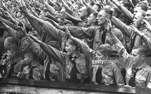 Nazi Rally with Hitler youth members in foreground 1936