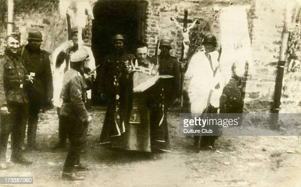 Nazi soldiers mocking a Catholic Rite in a town in Poland. Spanish postcard.