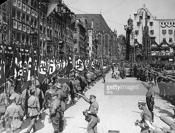 Nazi storm troops march past German Nazi leader Adolf Hitler at a parade in Nuremberg Germany during the Party Congress 10th September 1934