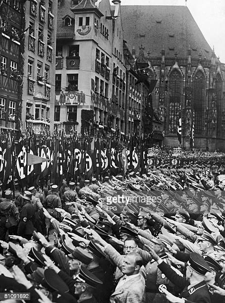 Nazi storm troops march through Nuremberg during the Party Congress Germany circa 1935
