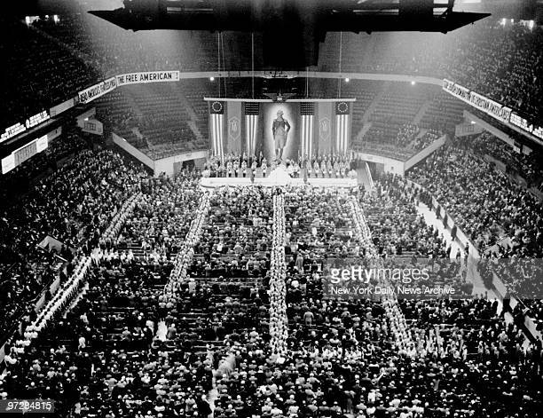 Nazi stormtroopers in double file fill the aisles as the crowd sings The Star Spangled Banner at the opening of the GermanAmerican Bund's...