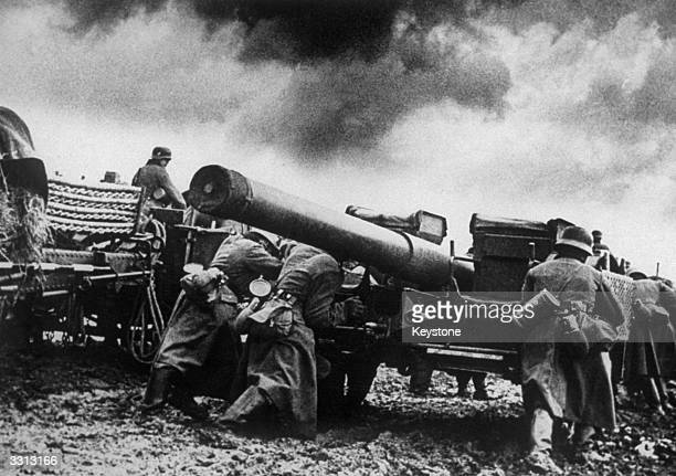 Nazi troops setting up their big guns on one of the many battle fronts in Norway