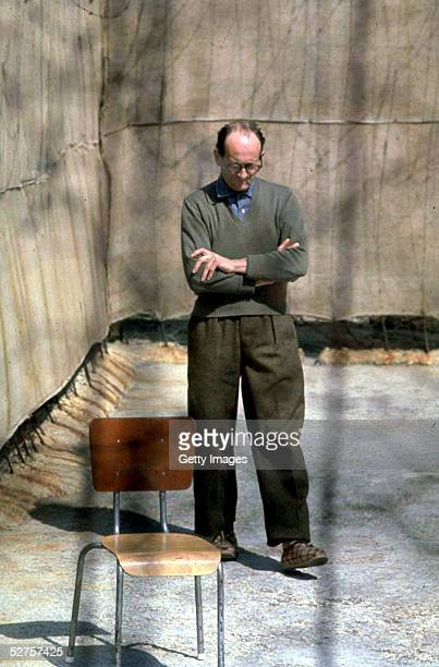 Nazi war criminal Adolf Eichmann paces in the yard at Ramle Prison, central Israel, ten days before the start of his trial, 1st April 1961.