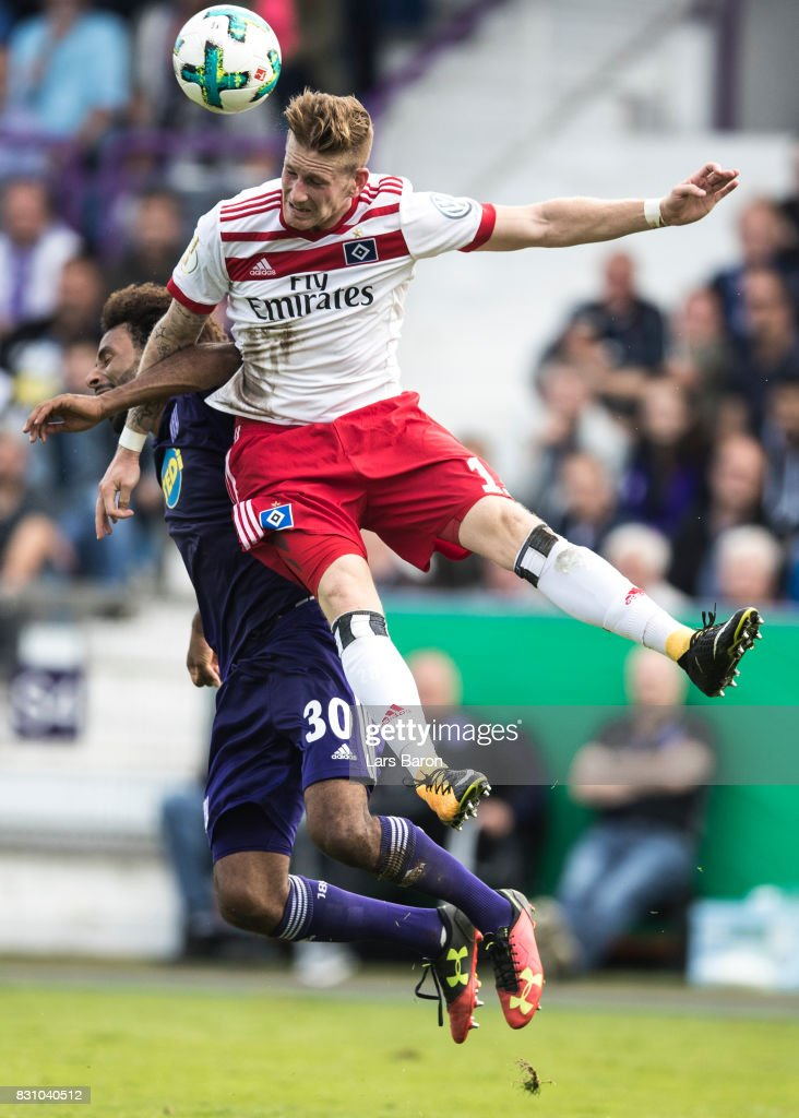 Nazim Sangare of Osnabrueck goes up for a header with Andre Hahn of Hamburg during the DFB Cup match between VfL Osnabrueck and Hamburger SV at Osnatel Arena on August 13, 2017 in Osnabrueck, Germany.
