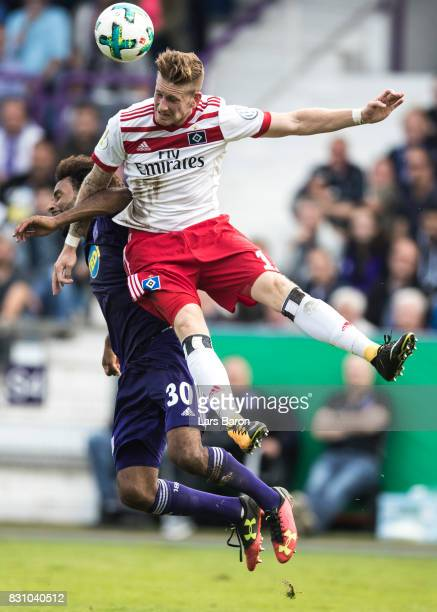 Nazim Sangare of Osnabrueck goes up for a header with Andre Hahn of Hamburg during the DFB Cup match between VfL Osnabrueck and Hamburger SV at...