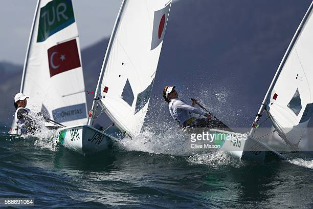 Nazli Donertas of Turkey and Lucia Falasca of Argentina competes in Women's Laser Radial class on Day 7 of the Rio 2016 Olympic Games at Marina da...