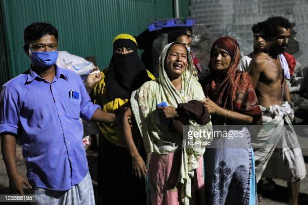 Nazma Akhter mourns for her missing son near a fire scene of a juice factory that killed at least 3 workers and left 26 injured at Rupganj,...