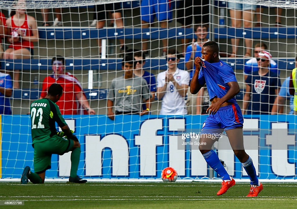 Nazon Duckens #20 of Haiti celebrates after scoring a goal against goalkeeper Donis Escober #22 of Honduras during the 2015 CONCACAF Gold Cup match at Sporting Park on July 13, 2015 in Kansas City, Kansas.