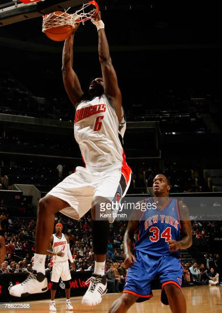 Nazr Mohammed of the Charlotte Bobcats dunks against Eddy Curry of the New York Knicks at the Charlotte Bobcats Arena December 21 2007 in Charlotte...