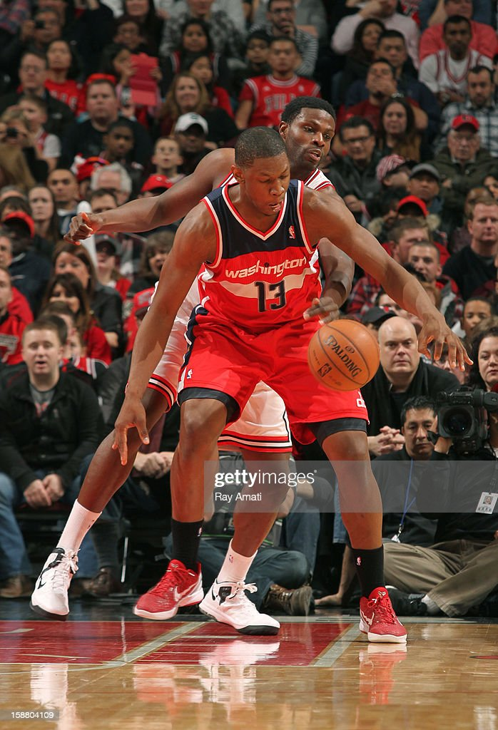 Nazr Mohammed #48 of the Chicago Bulls battles for the ball against Kevin Seraphin #13 of the Washington Wizards on December 29, 2012 at the United Center in Chicago, Illinois.