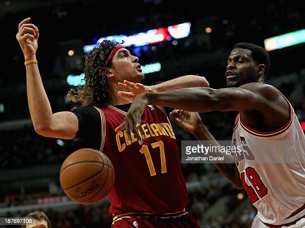 Nazr Mohammed of the Chicago Bulls knocks the ball away from Anderson Varejao of the Cleveland Cavaliers at the United Center on November 11 2013 in...