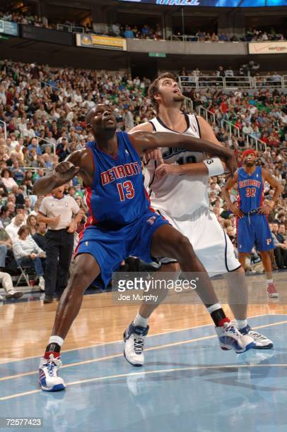 Nazr Mohammed of the Detroit Pistons and Mehmet Okur the Utah Jazz attempts to rebound the ball during the game on November 6 2006 at the Delta...
