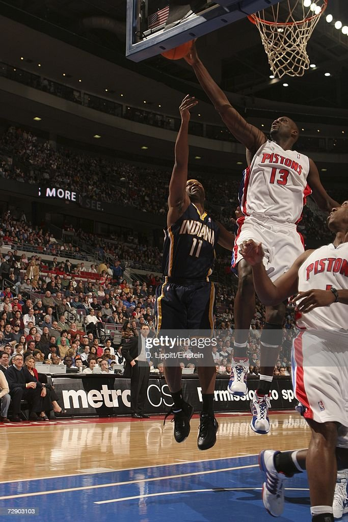 Nazr Mohammed #13 of the Detroit Pistons blocks a layup off of the backboard against Jamaal Tinsley #11 of the Indiana Pacers during a game at the Palace of Auburn Hills December 29, 2006 in Auburn Hills, Michigan.