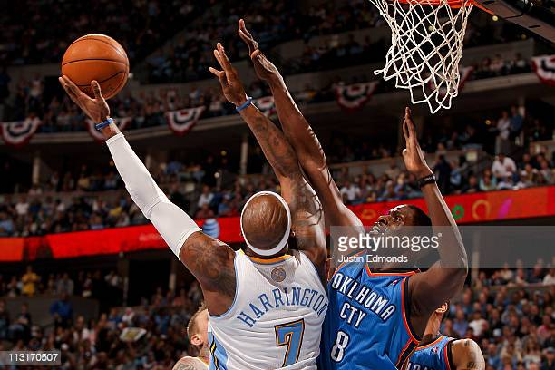 Nazr Mohammed of the Oklahoma City Thunder contests a shot by Al Harrington of the Denver Nuggets in Game Four of the Western Conference...