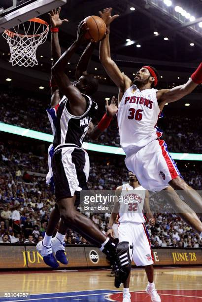 Nazr Mohammed of the San Antonio Spurs is stopped in the third quarter by Rasheed Wallace of the Detroit Pistons in Game five of the 2005 NBA Finals...