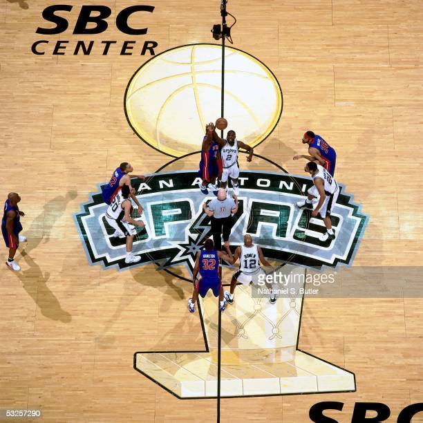 Nazr Mohammed of the San Antonio Spurs wins the opening tipoff against Ben Wallace of the Detroit Pistons in Game Seven of the 2005 NBA Finals June...