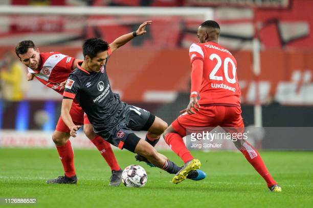 Nb14- of Nuernberg is challenged by Kevin Stoeger of Fortuna Duesseldorf during the Bundesliga match between Fortuna Duesseldorf and 1. FC Nuernberg...