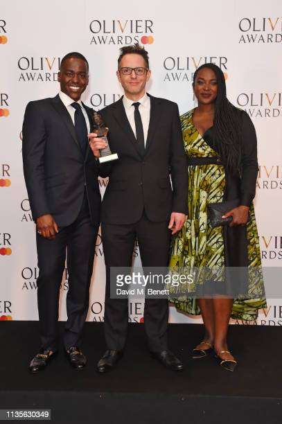 Ncuti Gatwa Jon Clark winner of the Best Lighting Design award for 'The Inheritance' and Wunmi Mosaku pose in the press room at The Olivier Awards...
