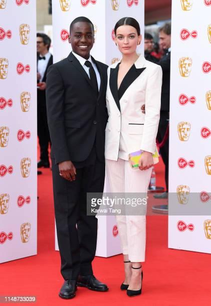 Ncuti Gawa and Emma Mackey attend the Virgin Media British Academy Television Awards 2019 at The Royal Festival Hall on May 12 2019 in London England