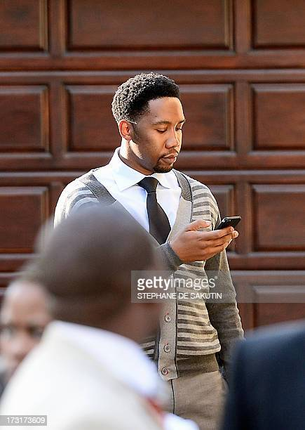 Ndaba Mandela brother of Mandla Mandela and grandson of former South African President Nelson Mandela looks at his phone on July 9 2013 after a...