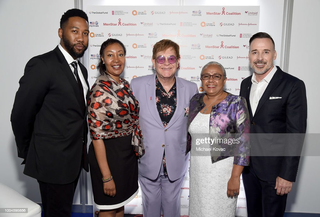 Ndaba Mandela, Chief of Staff of the First Lady of Kenya Constance Gakonyo, Sir Elton John, First Lady of the Republic of Kenya H.E. Margaret Gakuo Kenyatta, and EJAF Chairman David Furnish attend the Launch of the Menstar Coalition To Promote HIV Testing & Treatment of Men on July 24, 2018 in Amsterdam, Netherlands.