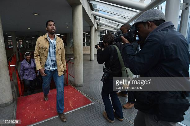 Ndaba Mandela grandson of Nelson Mandela followed by Ndileka leave the Mthatha high court after the verdict on July 3 2013 The South African court...