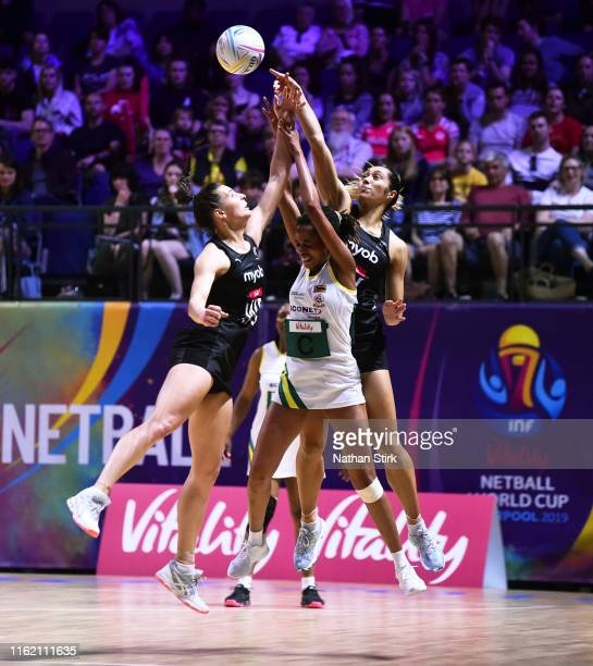 Ndaizivei Madzikangava of Zimbabwe and Karin Burger and JaneWatson of New Zealand in action during the preliminaries stage two schedule match between...