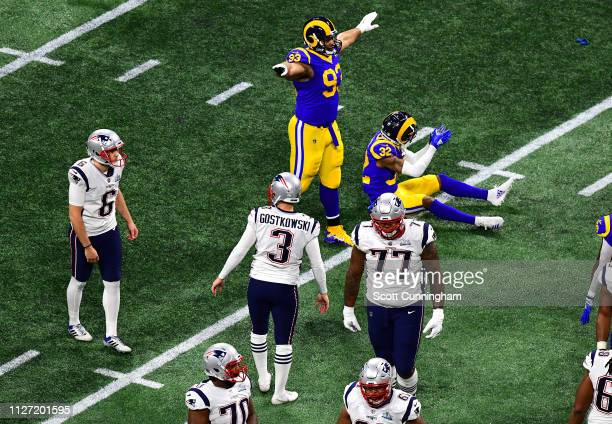 Ndamukong Suh and Troy Hill of the Los Angeles Rams react after a missed field goal by Stephen Gostkowski of the New England Patriots in the first...
