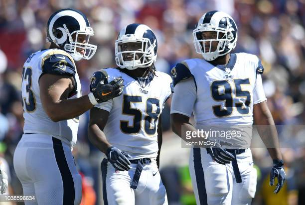 Ndamukong Suh Cory Littleton and Ethan Westbrooks of the Los Angeles Rams during action against the Arizona Cardinals at the Los Angeles Memorial...
