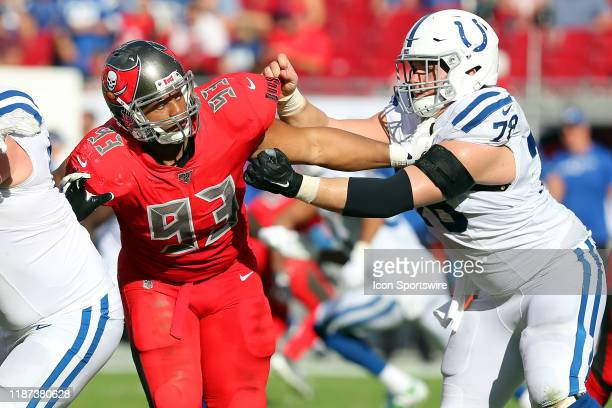 Ndamukong Suh of the Bucs attempts to rush the passer as Ryan Kelly of the Colts attempts to block Suh during the regular season game between the...