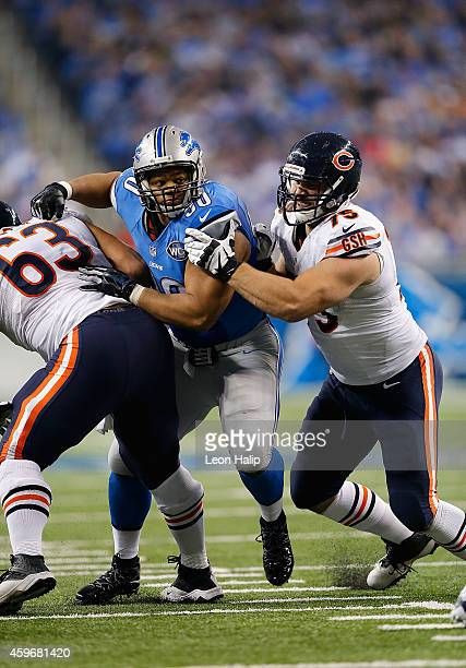 Ndamukong Suh of the Detroit Lions battles with Roberto Garza and Kyle Long of the Chicago Bears during the third quarter of the game at Ford Field...