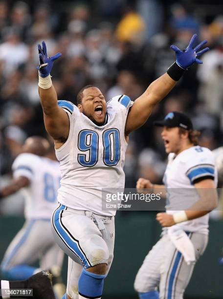 Ndamukong Suh of the Detroit Lions celebrates after they came from behind to beat the Oakland Raiders at O.co Coliseum on December 18, 2011 in...