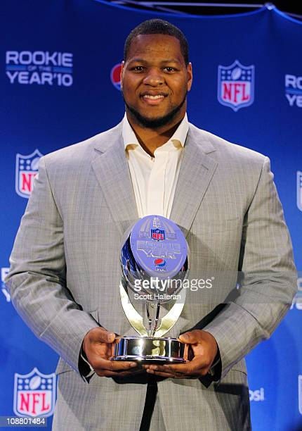 Ndamukong Suh of the Detroit Lions poses during a press conference where he accepted Pepsi's 2010 NFL Rookie of the Year Award at the Super Bowl XLV...