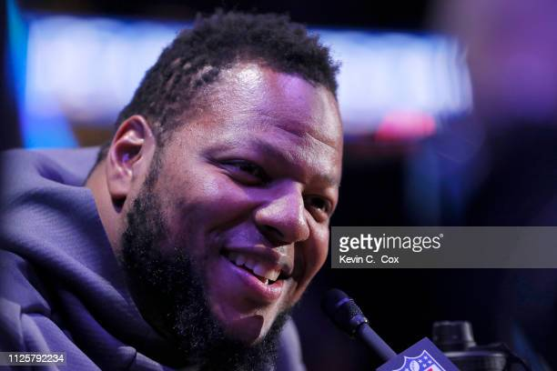 Ndamukong Suh of the Los Angeles Rams talks to the media during Super Bowl LIII Opening Night at State Farm Arena on January 28 2019 in Atlanta...