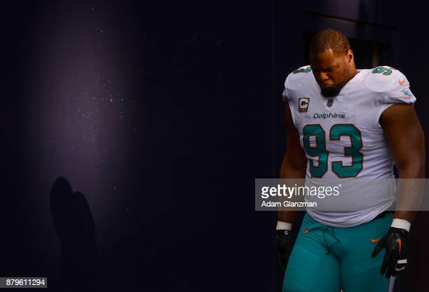 Ndamukong Suh of the Miami Dolphins exits the tunnel before a game against the New England Patriots at Gillette Stadium on November 26 2017 in...