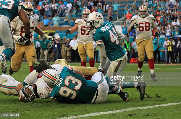 Ndamukong Suh of the Miami Dolphins stops Colin Kaepernick of the San Francisco 49ers on the final play of a game on November 27 2016 in Miami...