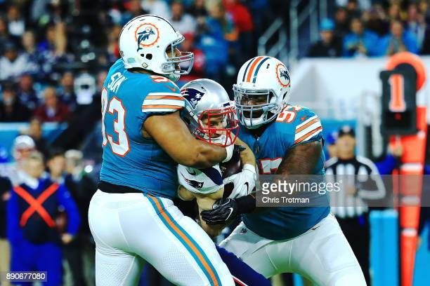 Ndamukong Suh of the Miami Dolphins with the stop on Rex Burkhead of the New England Patriots during the first quarter at Hard Rock Stadium on...