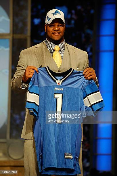 Ndamukong Suh of the Nebraska Cornhuskers holds up a Detroit Lions Jersey after he was picked overall by the Lions during the 2010 NFL Draft at Radio...