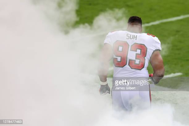 Ndamukong Suh of the Tampa Bay Buccaneers enters the field before the start of a game against the Los Angeles Chargers at Raymond James Stadium on...