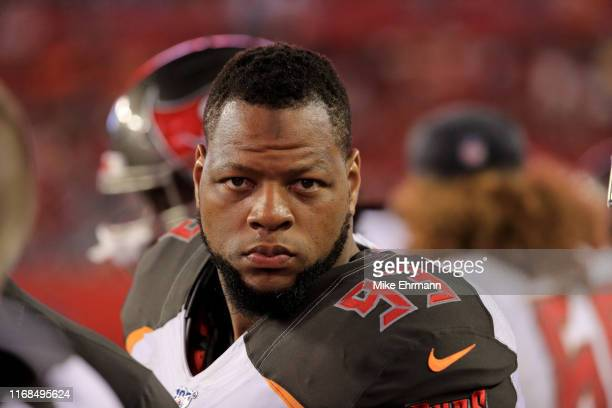 Ndamukong Suh of the Tampa Bay Buccaneers looks on against the Miami Dolphins in the second half during the preseason game at Raymond James Stadium...
