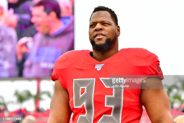 Ndamukong Suh of the Tampa Bay Buccaneers looks on from the sidelines before a football game against the New Orleans Saints at Raymond James Stadium...