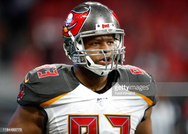 Ndamukong Suh of the Tampa Bay Buccaneers reacts after returning a fumble for a touchdown during the second half of an NFL game against the Atlanta...