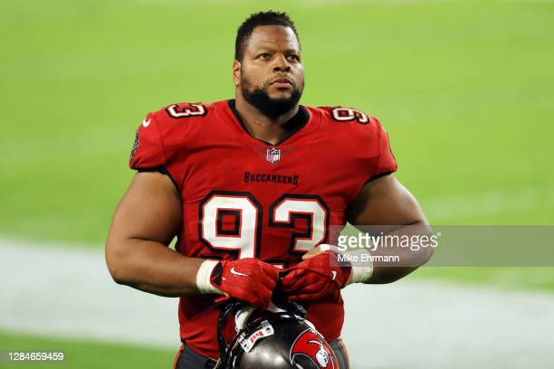 Ndamukong Suh of the Tampa Bay Buccaneers walks off the field after being defeated by the New Orleans Saints 38-3 at Raymond James Stadium on...