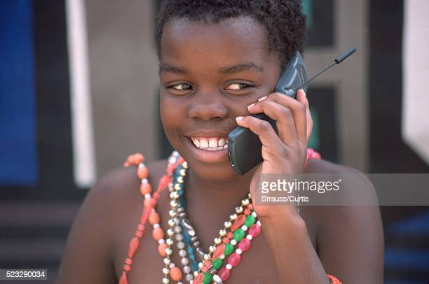 Ndebele girl using cell phone - Africa